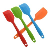 Silicone Heat Resistant Spatula. Different Candy Colours. Cake Baking, Cooking Tool. Stirring and Mixing