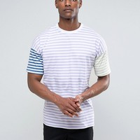 ASOS TALL Oversized T-Shirt With Pastel Stripe at asos.com
