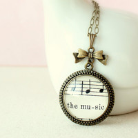 Music necklace made with real vintage sheet music.  Gift for musician, music lover, singer, wife, girlfriend