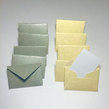 Mini gold or silver envelopes with tiny note cards 1x1.5""