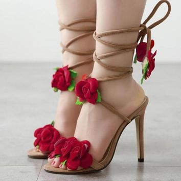 Ten roses crossed with high heels and sandals