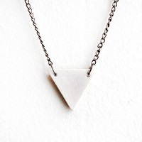 white bisque triangle necklace by ofmatter on Etsy