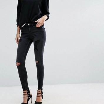 River Island Amelie Super Skinny Jeans With Ripped Knee at asos.com