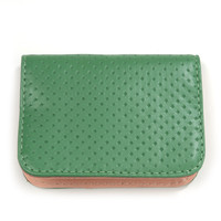 green perforated card case by Clare V.