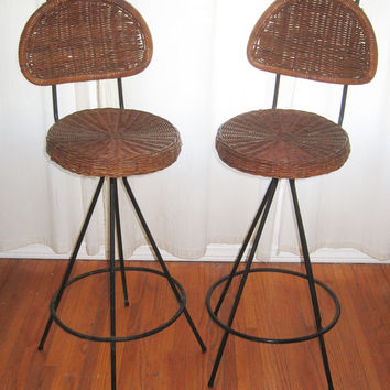 Pair of mid century iron/rattan tiki bar stools