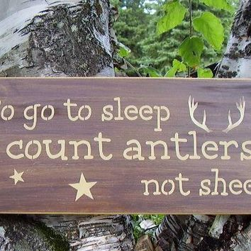 To go to sleep I count antlers, not sheep distressed wooden sign