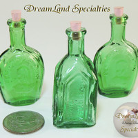 Vintage 3 Miniature Embossed Glass Bottles from DreamLand Specialties