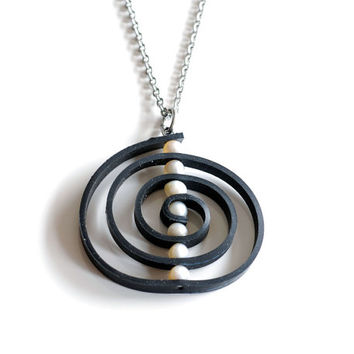 Upcycled bicycle inner tube spiral pendant handmade with recycled black rubber , white pearls & stainless steel , unique circle necklace