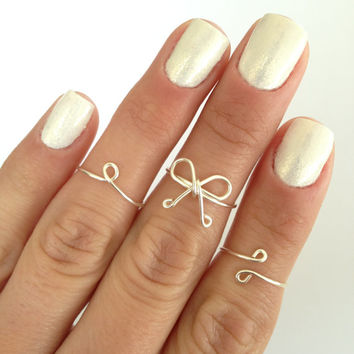 Set of Midi Below the Knuckle Rings, Dainty Bow, Simple Circle, and Double Dot Designs. Available in Silver, Gold and Pink Rose