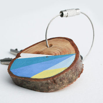 Pine wood keychain with stainless steel cable wire, blue and yellow geometric triangle shapes