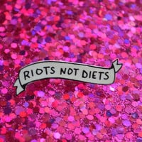 RIOTS NOT DIETS banner lapel pin