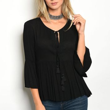 Ladies round neckline and tassel tie fashion knit top