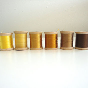 Vintage sewing thread lot of 6 wooden spools in hues of yellow, orange and brown