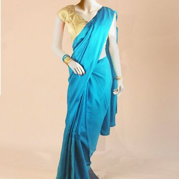 the satin silk saree in turquoise with subtle sequins
