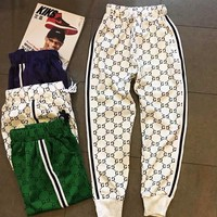 Gucci new couple sports pants Logo full printed breathable spandex cotton trousers casual men and women paragraph trousers White