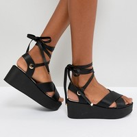 RAID Alma Black Ankle Tie Flatform Sandals at asos.com