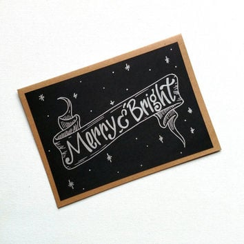 Hand lettered 'Merry and Bright' silver and black greeting card, blank holiday Kraft card, Christmas card with banner.