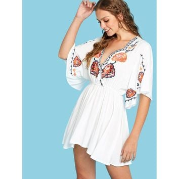 White Flower Embroidered Wrap Front Blouse