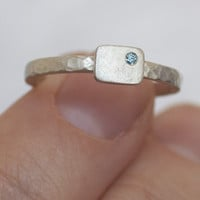 Silver cell ring with blue diamond