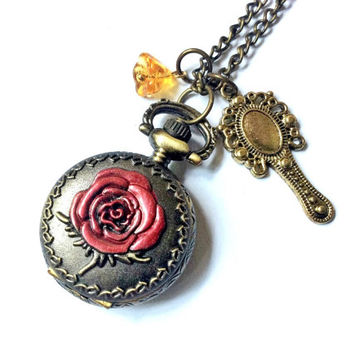 Tale As Old As Time watch necklace: rose pocket watch with a yellow bell flower bead and magic hand mirror charm