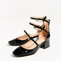 STRAPPY HEELED SHOES DETAILS