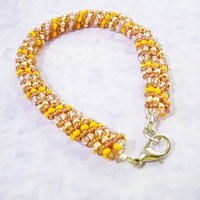 Russian Spiral bracelet in the colours orange, brown and gold - handmade, chic and elegant, festive