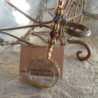 New very different gift a 10X magnfier gold and purple glass