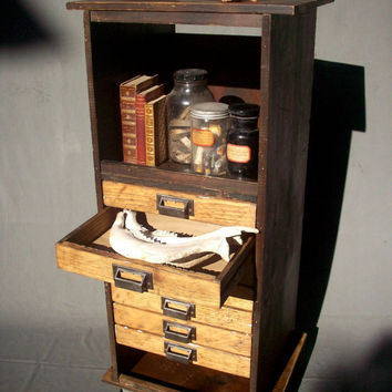 Collectors 7 Drawer Wood Cabinet with Steel Wheels / by urgestudio