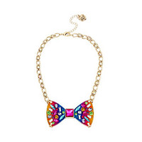 RAINBOW CONNECTION LUCITE BOW PENDANT: Betsey Johnson
