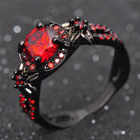 Black Ring and  Shiny Ruby Red Garnet