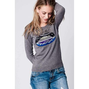 Grey sweater with sequin detail of lips on the front