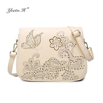 Yeetn.H Female High quality flowers and butterfly Hollow Out messenger bag women bag cross body bag Saddle PU Leather Y933