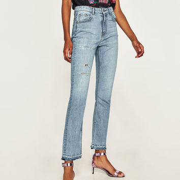 HIGH WAIST JEANS WITH SIDE SLITS