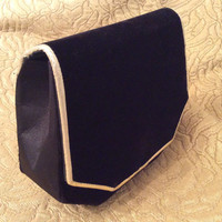 Black velveteen evening purse and matching box with gold trim.