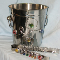 FUN and Functional Stainless Steel ice bucket and tongs with wire, and glass stones.