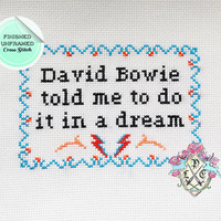 "Finished Unframed ""David Bowie told me to do it in a dream"" Flight of the Conchords Cross Stitch"