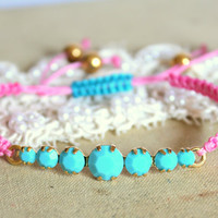 Friendship bracelet Turquoise and pink  braided with real Turquoise swarovski rhinestones .