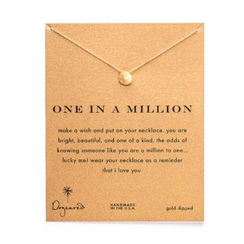 dogeared one in a million sand dollar necklace in gold dipped Day-First™