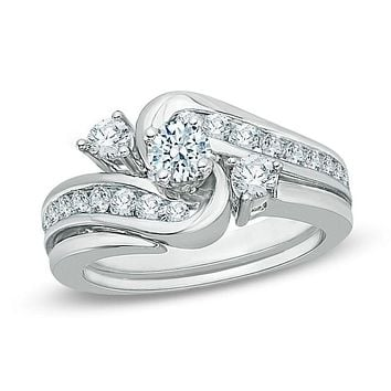 7/8 CT. T.W. Diamond Three Stone Slant Bypass Bridal Engagement Ring Set in 14K White Gold