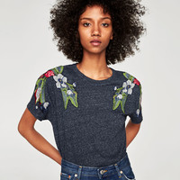 T-SHIRT WITH EMBROIDERED SHOULDERS DETAILS