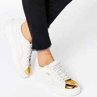 Puma Suede Platform Sneakers In White With Gold Toe Cap at asos.com
