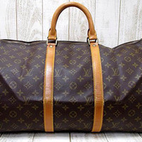 Vintage Louis Vuitton monogram travel keepall 50 duffle bag. Bandouliere purse. Great vintage condition. Unisex use for all generations.