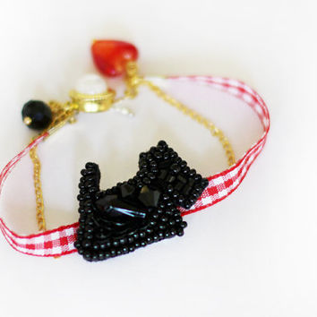 Bracelet black Scotch terrier embroidery of beads on a red ribbon