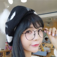 Black and white wool beret