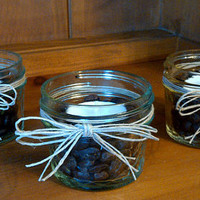one mason jar candle holder with whole coffee beans