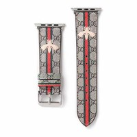 Gucci Monogram Stripes & Bee Apple Watch Band - Gold