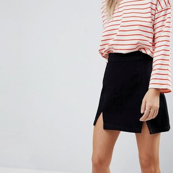 ASOS PETITE Denim Mini Skirt in Washed Black With Split Detail at asos.com