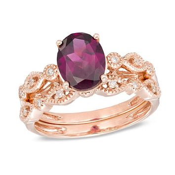 Oval Rhodolite and 1/10 CT. T.W. Diamond Vintage-Style Bridal Engagement Ring Set in 14K Rose Gold